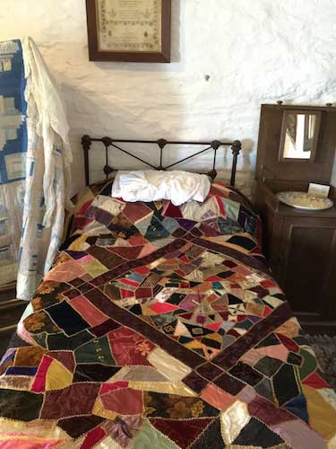 victorian crazy quilt on a bed