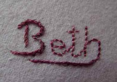 a name embroidered on a blanket