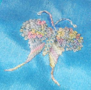Butterfly worked in French knots