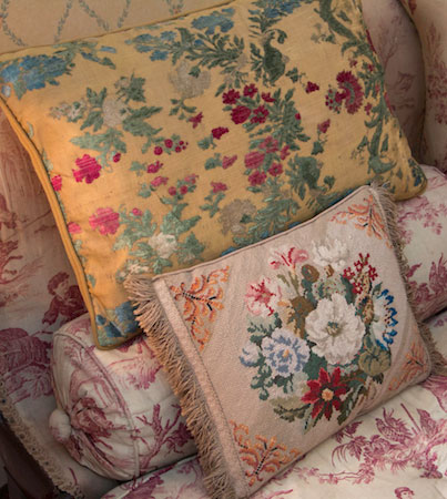 A pile of needlepoint cushions at Arlington Court in Devon