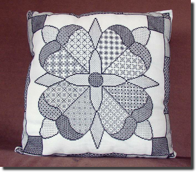 Blackwork rose sampler cushion