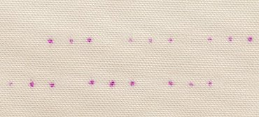 Dots on fabric ready for stitching