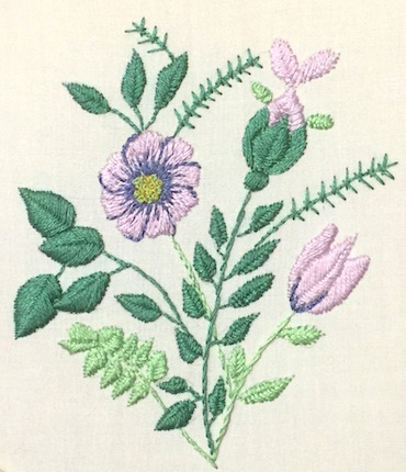 Floral embroidery with raised fishbone leaves and flowers