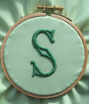 Padded satin stitch initial